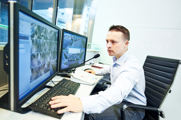security guard officer watching video monitoring surveillance se